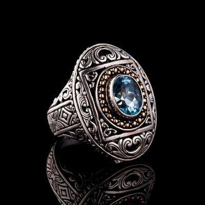 Blue Topaz Silver Ring With Gold